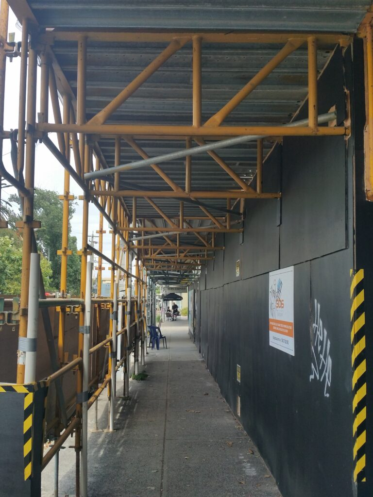 scaffold gantry protecting public from adjacent site activities